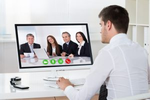 Businessman Videoconferencing On Desktop Computer